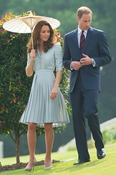 The Duke and Duchess visited the Commonwealth war graves in Singapore on the third day of their Diamond Jubilee tour. She wore a Jenny Packham duck egg blue dress for the occasion and carried a parasol.