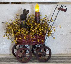 Beeswax bunny sitting in baby buggy