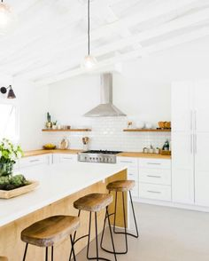 open, warm, wood and white kitchen