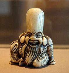 012-Netsuke de Fukurokuju dios de la sabiduria talla en marfil- Wikimedia Commons