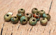 6 Mykonos Greek Ceramic Beads - 6mm Round Raku Sea & Moss - Small Pearls. $7.45, via Etsy.