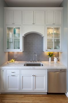 Superb White Kitchen With Glossy Gray Subway Tile, Marble Countertops, Lighted  Glass Cabinets And Arch Detail Over Sink   By Tineke Triggs Of Artistic  Designs For ... Part 15