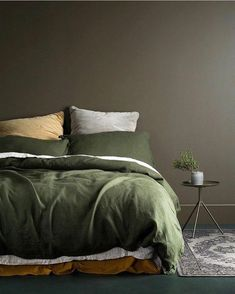 Terrific Love this muddy brown feature wall and olive green bedding. Such a warm palette! The post Love this muddy brown feature wall and olive green bedding. Such a warm palette!… appeared first on Decor . Green Bedding, Bedroom Green, Bedroom Colors, Home Bedroom, Bedroom Decor, Bedroom Ideas, Dark Bedding, Olive Bedroom, Master Bedroom