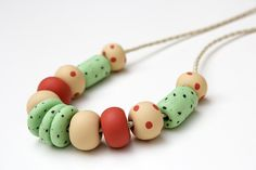 Beautiful minimal polymer clay necklace. Perfect for everyday wear or special occasions. The round beads of this necklace were rolled and shaped freehand, then baked strung onto a leather cord with sterling silver lobster clasp. Each necklace is unique, with every bead and piece handcrafted with love and care. Visit my store: www.etsy.com/shop/SunlightGarden Polymer Clay Necklace, Leather Cord, Round Beads, Lobster Clasp, Special Occasion, Minimal, Necklaces, Sterling Silver, Store