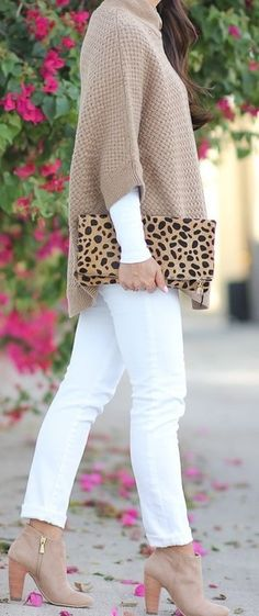 ❤️ High fashion and comfort at affordable prices. White skinny jeans, beige poncho sweater, leather clutch and ankle boots.