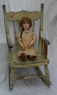 Nana had a doll with wooden arms and legs that had joints at the elbows and knees. Very similar to this one.