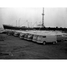 Volkswagen vans in parking lot with nautical vessel in background Canvas Art - (18 x 24)