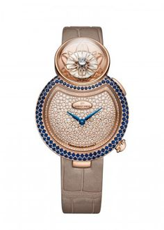Lady 8 Flower | 18-karat red gold dial set with 353 diamonds, total of 1.38 carats. 18-karat red gold case and applied ring set with 114 blue sapphires and 88 diamonds, buckle set with 47 diamonds, total of 1.61 carats (sapphires) and 0.64 carat (diamonds). Mechanical opening flower automaton movement. 18-karat red gold skeleton petals. Diamond briolette, total of 0.24 carat. Self-winding mechanical hours and minutes movement. Power reserve of 38 hours.