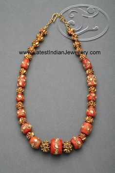 Intricate Gold Work on the Corals Studded with Kundans enhances the look - Latest Indian Jewellery Designs Bijoux Design, Gold Jewellery Design, Bead Jewellery, Schmuck Design, Jewellery Shops, Jewelry Stores, Jewellery Holder, Silver Jewellery, Coral Jewelry