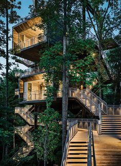 The Boy Scouts of America builds a sustainable tree house in West Virginia. Visitors learn about energy and water conservation as they climb outdoor staircases that lead from the forest floor to the 125-foot-high rooftop rising above the leaf canopy. Photo by Joe Fletcher.