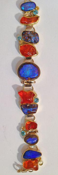 Boulder opal and Mexican opal bracelet in 22k and 18k gold. by Jennifer Kalled; Boulder opal from Bill Kasso