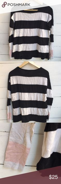 H&M Striped Sweater Super cute and cozy black, white, and pink striped sweater. Trendy and perfect for a cool winter day. Great condition! H&M Sweaters Crew & Scoop Necks