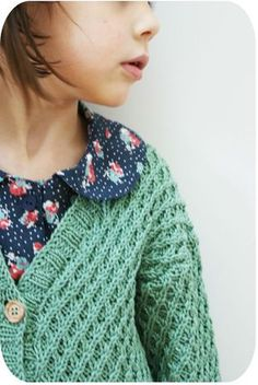 sweater and floral blouse