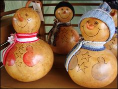 gourd crafts | Bottle gourds crafted into snowmen on display at a local craft show.