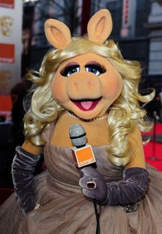 Miss Piggy interviewing on the Red Carpet........
