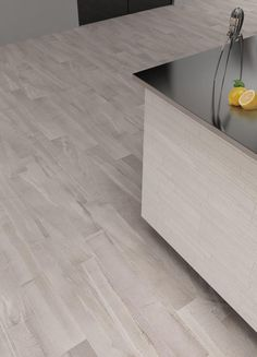 Vermont White Porcelain - Mandarin Stone - replicating the beauty of honed slate, tile and plank format in a range of colours.