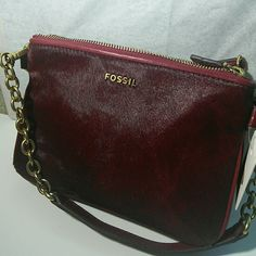 Fossil Memoir Cranberry Pocketbook Top Zip HC A brand new Fossil Double Top Zip Pocketbook with actual calf hair .Comes with Dust bag. Fossil Bags Clutches & Wristlets
