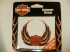 "Harley Davidson Motorcyle Temporary Tattoo Belly Button with Eagle Wings by Harley-Davidson. $6.99. apporximately 3.5"" x 2.5"" in length. easy to apply. lasts for days. Harley Davidson temporary tattoo. realistic looking. safe, non toxic won't come off in pool or shower.  removes with alcohol, baby oil or adhesive tape."