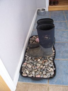 Stone boot tray! Great idea especially in MN winters, the tray will collect the water instead of it going all over the floor! Maybe have two trays, the top one with holes so you can strain and don't have to deal with the rocks when emptying the water.