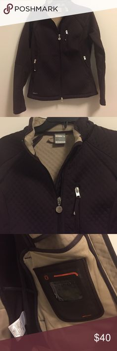 Nike ThermaFit Jacket Brown jacket with plenty of pockets on the front, back and inside. Tech pocket included. Great against the elements when running or exercising. Size medium Nike Jackets & Coats