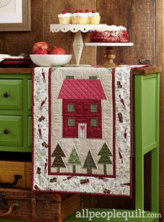 Christmas Cottage table runner pattern by Diane Nagle, from American Patchwork & Quilting, December 2015 issue.
