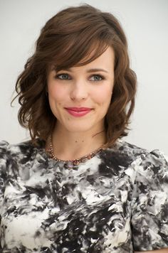 love the short hair style with curls and side swept bangs