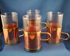 Set of 4 Copper and Glass Cups with Brass Handles 4 Oz Vintage Sturbridge Yankee Workshop. $31.99, via Etsy.