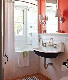Bathroom Lighting A light and bright bath gives airy appearance.  Hang sconces and little bright paint is the big suggestion here.  Bob Vila