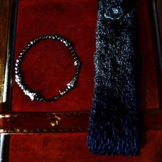 """Men's smart-wear  Set Black Cashmere Tie and hematite bracelet """"Metallic Matrix"""" wearable-tech for Charity.  TO BUY: Comment with your email address and you'll receive a secure checkout link.  Price: $289.00.  The classic black knit tie in a beautiful cashmere texture is a style staple for the modern man. Wear your versatile couture tie in business to a formal event to a club around town with a T-Shirt and jeans even with a tank top and vest.  Smart-wears Wearables Handmade Set includes…"""