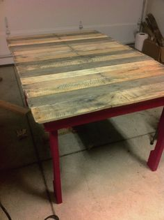 Pallet table i'm building! Its not completely finished, but its coming together! Spent about $30 on supplies including some lumber for the frame, nails, screws, paint, stain, polyurethane and sandpaper. Most of the wood is reclaimed and was FREE! This was a super fun DIY project and easy too!  #reclaimed #wood #pallets #table #DIY