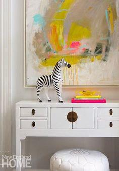 A simple and colourful entryway console with a zebra