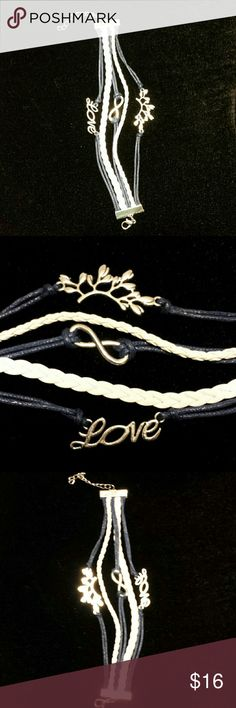 "NWT Navy Blue/White Infinity Love Leaves Bracelet New With Tag Fashion Jewelry Navy Blue/ Multi-strand Infinty Love Branch with Leaves Bracelet approximately 9"" Long. It has flaws on it & package when I got it but it's brand new, never been used. Just took it out to take pics. Feel free to ask questions. From Non-Smoking, Pet Friendly Home. NO Trades, OPEN for Best Reasonable Offers and Bundles using the provided buttons, Please NOT in the Comments.  Please also check out my other items…"