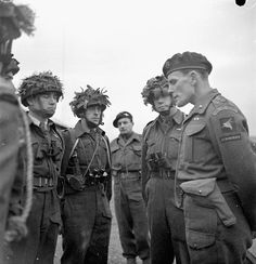Brigadier S. James L. Hill (right), Commander of the 3rd Parachute Brigade, briefs officers of the 1st Canadian Parachute Battalion, Carter Barracks, Bulford, England, 6 December 1943. (L-R at left): Captain R.A. MacDonald, Major P.R. Griffin, an unidentified British Airborne officer and Major Jeff A. Nicklin