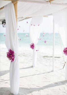 How incredible is this backdrop for a beach wedding?