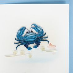 Quilled greeting card with blue crab on front