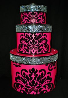 "3 Tier Cake Card Box ~ Hot Pink with Large Black Felt Damask Print. Black and Silver/Irredesent Ribbon with Rhinestone accents.     12 1/2 "" Dia; 20 1/2 "" Tall. The 2nd Tier lid comes off to get to the cards out. There is a an open slot to put the cards in at the top.  $65"