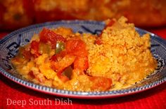 Tomato Casserole - Fresh garden tomatoes, in a casserole made with the trinity of Deep South veggies - onion, bell pepper and celery - topped with shredded cheddar cheese and buttery crackers.