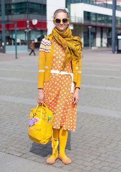 "Heidi, 25: ""Colours and fairytales inspire my style. I can't wear black, but any other colours I can mix freely. Yellow is my favourite colour, as you can see.  Pippi Longstocking is my style icon."" (13 May 2011, Kellosaarenkatu, Helsinki)"