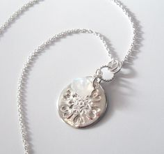 Snowflake Fine Silver Pendant Necklace with Moonstone, Eco Friendly. $58.00, via Etsy.