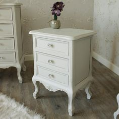 Elise Grey Range - 3 Drawer Bedside Table Ornate Distressed Grey Painted Three Drawer Bedside Designed with a beautifully carved body and elegant legs Finished with crystal knobs for a unique look Made from a combination of Beech and Birch type wood