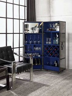 An unusual, art-deco drinks cabinet.  What do you think of that royal blue? #vintage