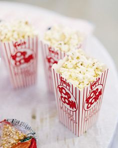 fresh popcorn for the guests at this carnival themed wedding  Photography by nathanabplanalp.com