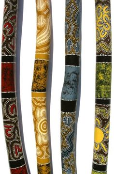 Mallee ant eaten didgeridoos, crafted and decorated by Aboriginal Artists.