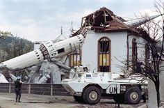 French troops of the United Nations patrol in front of the destroyed mosque of Ahinici, near Vitez, northwest of Sarajevo, on April 27, 1993. (Pascal Guyot/AFP/Getty Images)