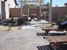 two-toned stamped concrete sun deck and dining areas with natural grey stepping stone paths between