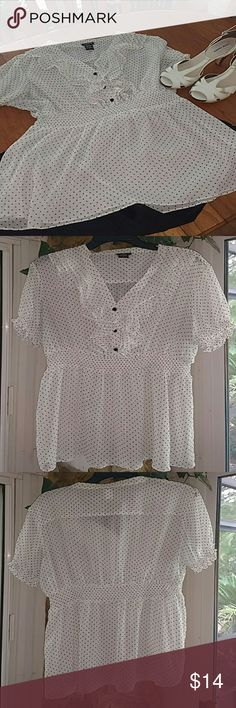 Pretty Polka Dot Top from Torrid sz 1 Cute White with Black Polka Dot Top from Torrid. Ruffle front detail with buttons. Sheer, so you will need a Cami underneath it.  Excellent used condition, Torrid size 1  **All items from cover shot are listed in my closet. Make a bundle deal!! :) torrid Tops Blouses
