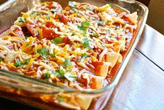 Shredded Chicken Enchiladas - Ready To Bake - added black beans, 1 cup sour cream and avocado slices to the chicken mix