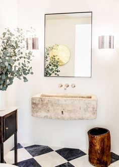 :: Havens South Designs :: loves the floating stone sink with the simple mirror and wall faucets.