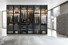 Vitrum is a sophisticated wardrobe with smoked glass doors available from IQ Furniture.