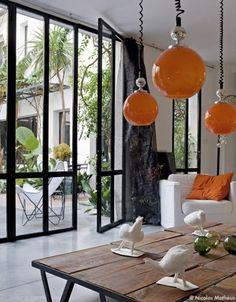 Casa Honoré, Marseille. Floor to ceiling doors. Polished concrete floors.